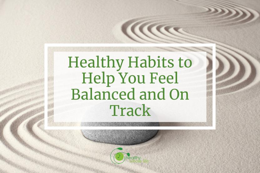 healthy habits balance rock sand